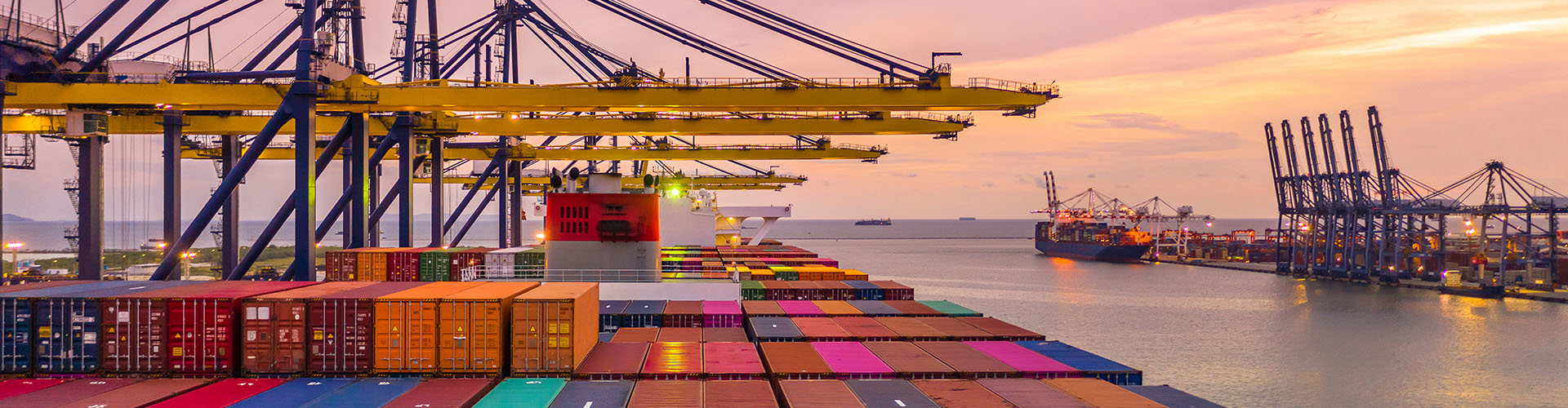 Container ship loading and unloading in deep sea port at sunset, Aerial view of business logistic import and  export freight  transportation by container ship in open sea.